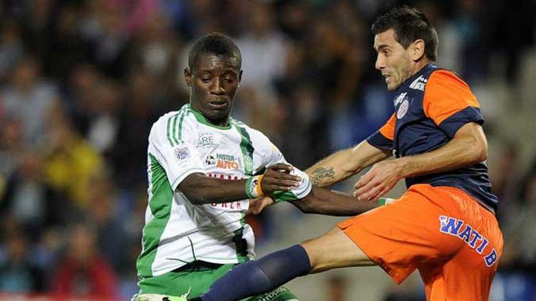 Le joueur de Montpellier Cyril Jeunechamp (à droite) réagit après sa suspension