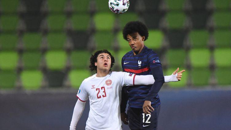 Jules Koundé face au Danemark (ATTILA KISBENEDEK / AFP)