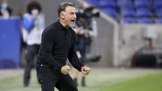 Le Marseillais Christophe Galtier, entraîneur du Losc, jubile lors de sa victoire face à Lyon, dimanche 25 avril au Groupama Stadium, à Décines (Rhône). (JEAN CATUFFE / AFP)