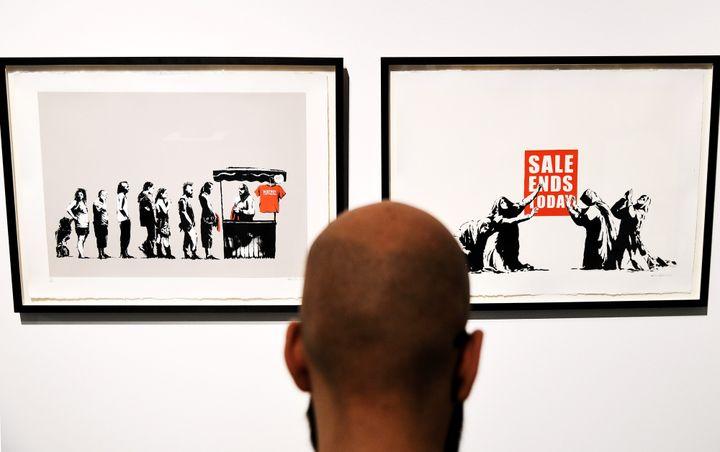 """""""Festival"""" et """"Sale Ends"""" de Banksy  (VINCENZO PINTO / AFP)"""