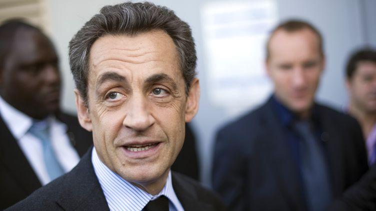 En déplacement à Suippes (Marne), Nicolas Sarkozy le 15 mars 2012 (LIONEL BONAVENTURE / AFP)