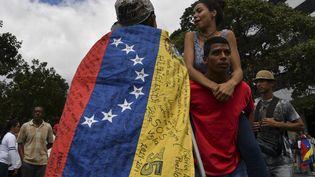 Des opposants à Nicolas Maduro manifestent à Caracas (Venezuela), le 30 janvier 2019. (YURI CORTEZ / AFP)