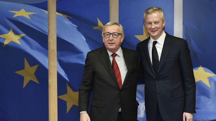 Bruno Le Maire et Jean-Claude Juncker à Bruxelles, le 5 décembre. (JOHN THYS / AFP)