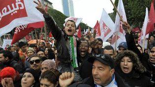 Tunisiens célébrant le second anniversaire de la révolution et du renversement de la dictature de Zine el-Abidine Ben Ali; le 14 janvier 2013 à Tunis. (AFP - FETHI BELAID)