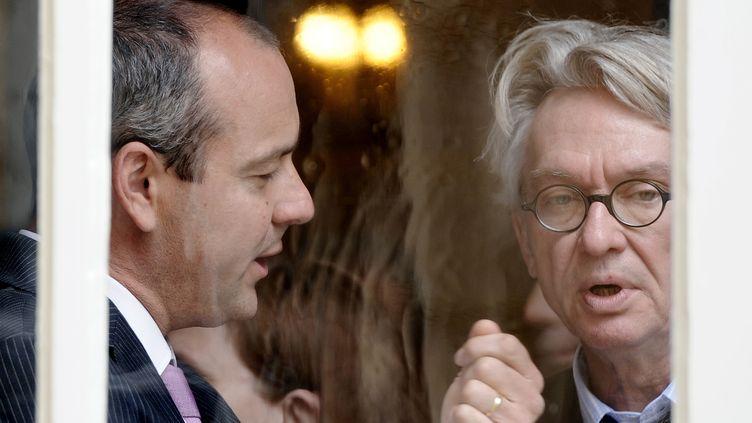 Laurent Berger, secrétaire général de la CFDT, et Jean-Claude Mailly, secrétaire général de FO, après une réunion avec Matignon, le 16 juin 2014. (STEPHANE DE SAKUTIN / AFP)