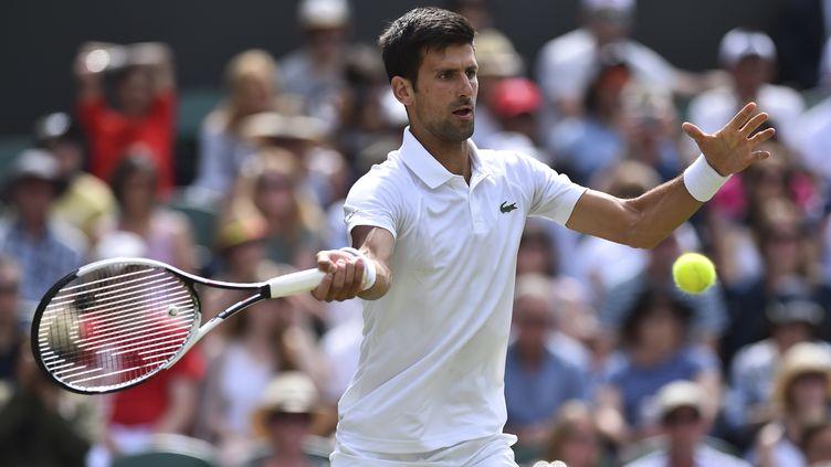 Début de tournoi tranquille pour Novak Djokovic (GLYN KIRK / AFP)