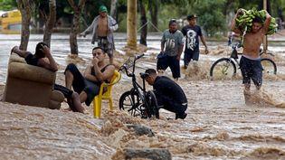Une rue inondée à El Progreso, au Honduras, le 18 novembre 2020, après le passage de l'ouragan Iota. (AFP)