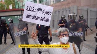 Une manifestante contre le reconfinement à Madrid (Espagne) (FRANCEINFO)