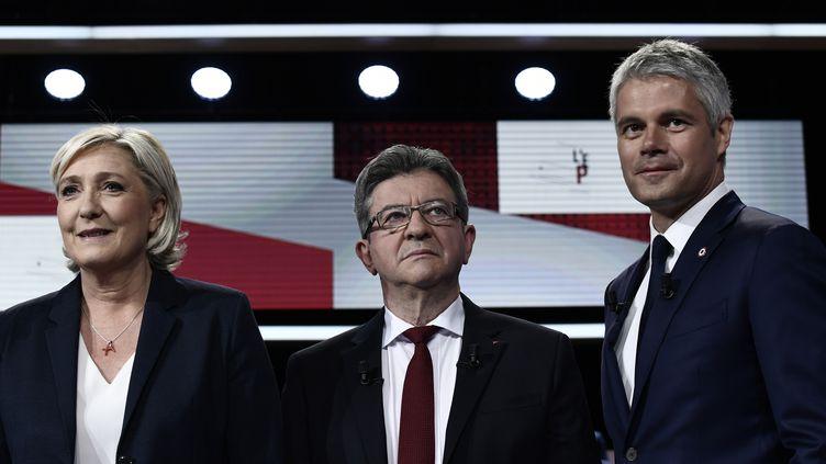"""Marine Le Pen, Jean- Luc Mélenchon et Laurent Wauquiez, sur le plateau de """"L'Emission politique"""", le 17 mai 2018. (PHILIPPE LOPEZ / AFP)"""