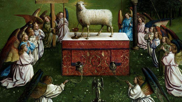 """Détail de la partie récemment restaurée de """"l'Agneau mystique"""" (1432) des frères Van Eyck, photographié le 17 décembre au Musée des Beaux-Arts de Gand (KENZO TRIBOUILLARD / AFP)"""