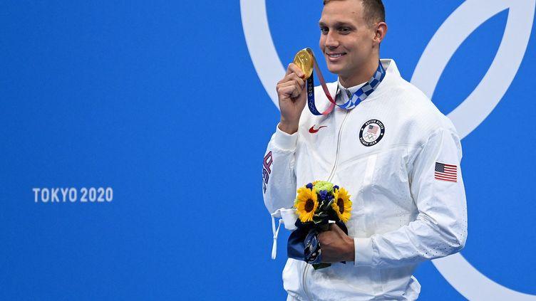 Caeleb Dressel après sa victoire sur le 100m papillon lors des Jeux olympiques de Tokyo, le 31 juillet (JONATHAN NACKSTRAND / AFP)