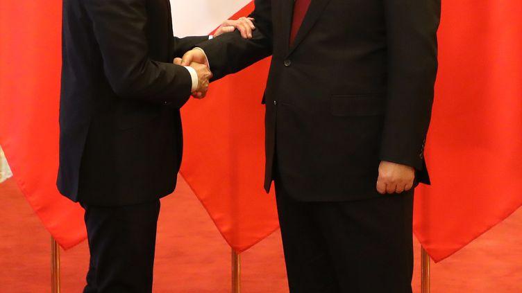 Emmanuel Macron et son homologue chinois, Xi Jinping, le 9 janvier 2018 à Pékin (Chine). (LUDOVIC MARIN / POOL / AFP)