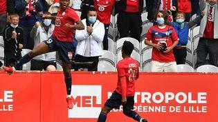 Grâce a un beau but d'attaquant de pointe, Jonathan David a donné la victoire à Lille, face à Montpellier, dimanche 29 août (2-1) (DENIS CHARLET / AFP)