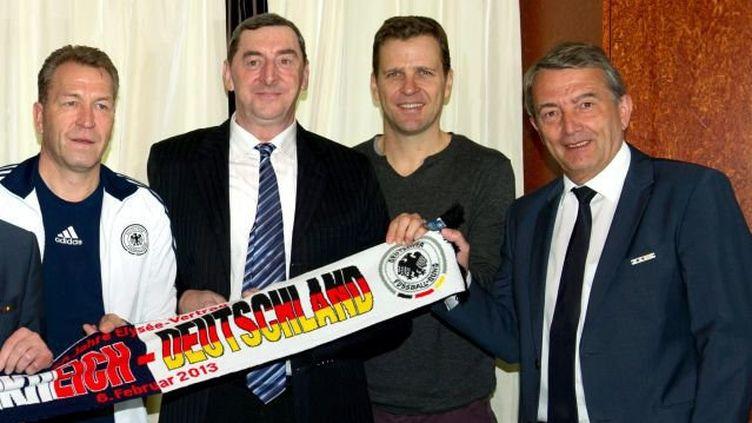 Le gendarme Nivel (en costume à gauche) aux côtés d'anciens joueurs et responsables de la Fédération allemande de football en 2013. (MAXPPP)