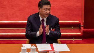 Le président chinois Xi Jingping à Pékin (Chine), lors de l'annonce du changement du système électoral à Hong-Kong, le 11 mars 2021. (NICOLAS ASFOURI / AFP)