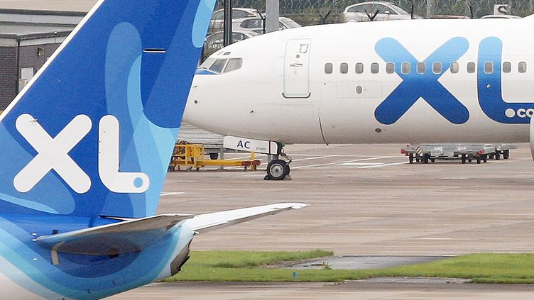 Des avions XL Airways sur l'aéroport de Manchester (Grande-Bretagne). (PAUL ELLIS / AFP)