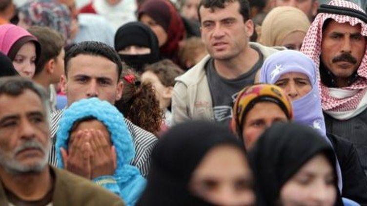 Les réfugiés syriens attendent leur tour à un centre d'inscription de l'Agence des Nations Unies pour les réfugiés à Tripoli (au nord du Liban), le 3 avril 2014. (AFP PHOTO / JOSEPH EID)