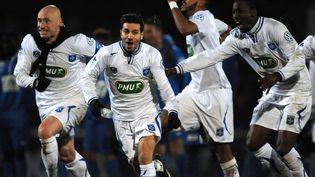 Les joueurs d'Auxerre le 20 février 2015 à Le Poire-sur-Vie, lors d'un match de Coupe de France. (JEAN-FRANCOIS MONIER / AFP)