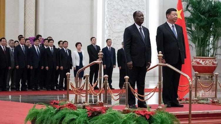 Le président chinois Xi Jinping reçoit son homologue ivoirien Alassane Ouattara à Pékin, le 30 août 2018. (Photo AFP/Roman Pilipey)