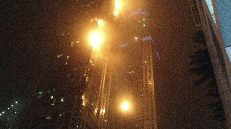 Un incendie s'est déclaré, le 21 février 2015, dans un gratte-ciel résidentiel deDubaï. (DAVID FRENCH / REUTERS)
