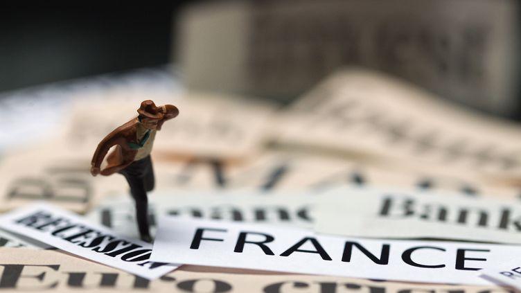 62% des Français ne croient pas à un retour de la croissance avant 2017, selon un sondage publié le 9 janvier 2014. (JOEL SAGET / AFP)