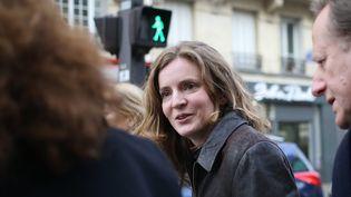 Nathalie Kosciusko-Morizet dimanche 22 décembre 2013 en campagne dans les rues de Paris. (KENZO TRIBOUILLARD / AFP)