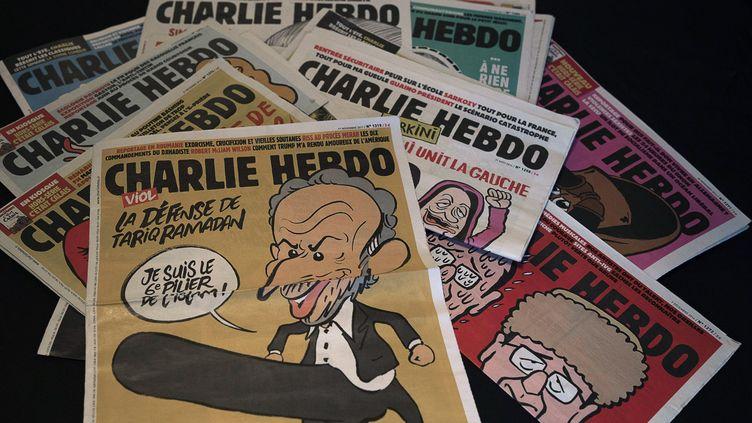 """Des unes de """"Charlie hebdo"""". (ROLAND MACRI / MAXPPP)"""
