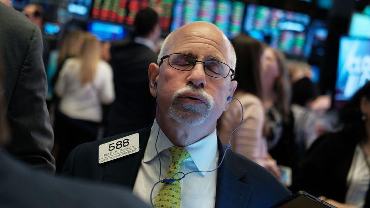 Réaction d'un trader à la fermeture de la Bourse de New-York le 31 juillet 2019. (SPENCER PLATT / GETTY IMAGES NORTH AMERICA)