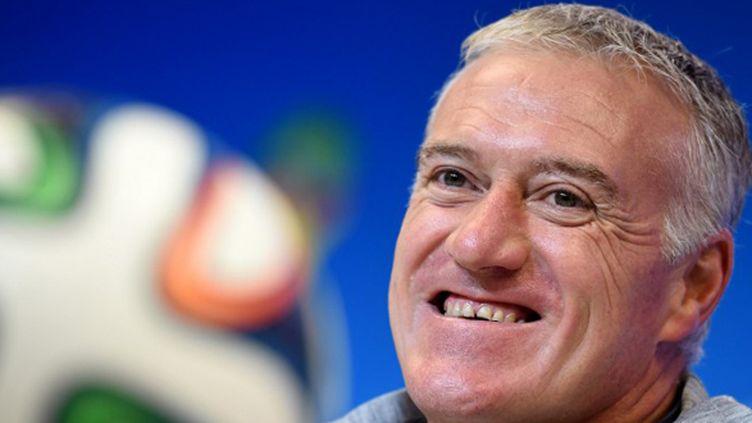 Didier Deschamps tout sourire en conférence de presse (MARIUS BECKER / DPA)
