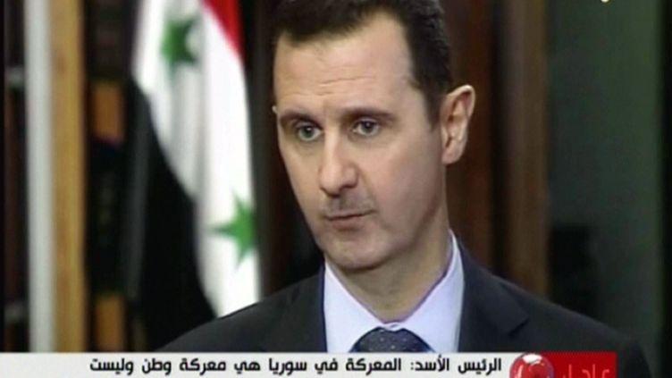 Le président syrien Bachar al-Assad lors de son interview diffusée par la chaîne du Hezbollah libanais, jeudi 30 mai 2013. (AL-MANAR / AFP)