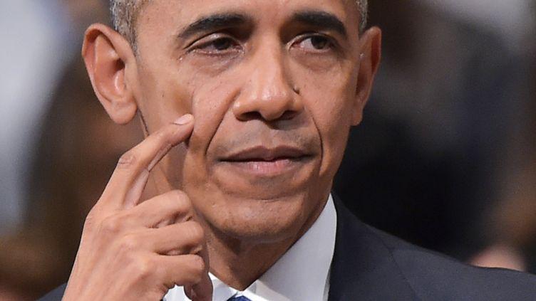 Le président des Etats-Unis Barack Obama prononce une allocution lors d'une cérémonie oecuménique aux cinq policiers abattus, le 12 juillet 2016 à Dallas. (MANDEL NGAN / AFP)
