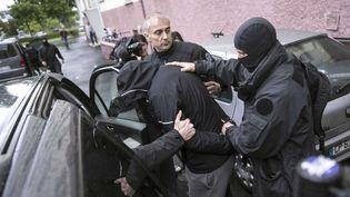 (L'arrestation d'un des suspects de cette filière de Strasbourg en mai 2014 © Jean Francois Badias/AP/SIPA)