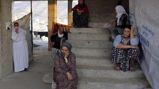 Des femmes yézidies dans un camp de réfugiés, au sud ouest de la province deDahuk, région autonome du Kurdistanen irakien, en 2014. (YOUSSEF BOUDLAL / REUTERS)