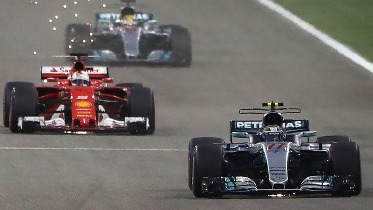 Mercedes ne va pas laisser Ferrari s'échapper. (KARIM SAHIB / AFP)