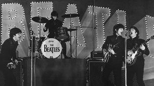 Les Beatles sur scène au Japon en 1966  (JIJI PRESS / AFP)