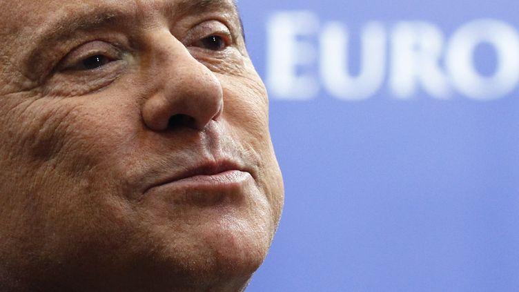 Le président du Conseil italien, Silvio Berlusconi, lors du sommet européen de Bruxelles (Belgique), le 27 octobre 2011. (FRANCOIS LENOIR / REUTERS)