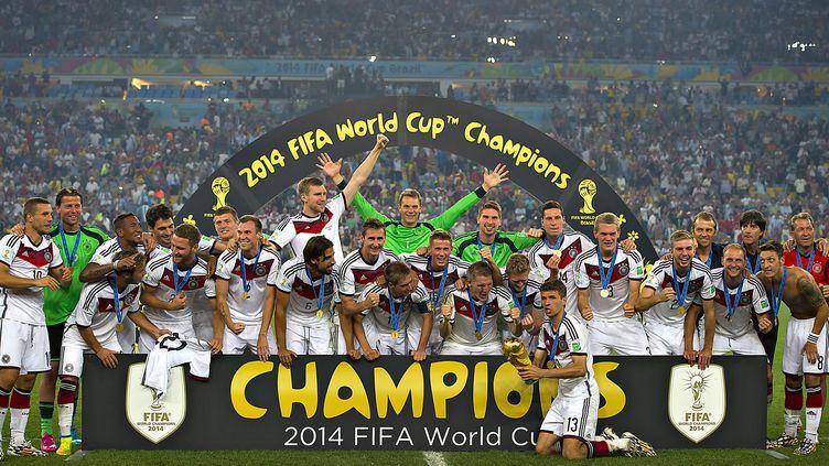 Les joueurs allemands célèbrent leur victoire face à l'Argentine, dimanche 13 juillet 2014,à Rio (Brésil),en finale de la Coupe du monde. (OSVALDO AGUILAR / MEXSPORT / AFP)