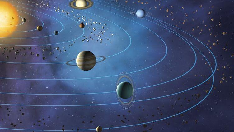 Les huit principales planètes du système solaire tournant en orbite autour du Soleil. (MARK GARLICK / SCIENCE PHOTO LIBRA / MGA / AFP)