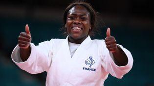 La judokate française Clarisse Agbégnénou célèbre sa victoire sur la Slovène Tina Trstenjak, en finale des moins de 63 kg,aux JO de Tokyo, le 27 juillet 2021. (FRANCK FIFE / AFP)