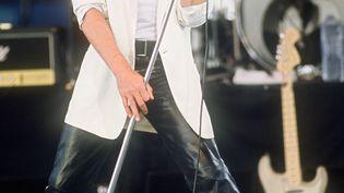 Johnny Hallyday à laFête de l'Humanité, le 15 septembre 1985. (MICHEL GANGNE / AFP)