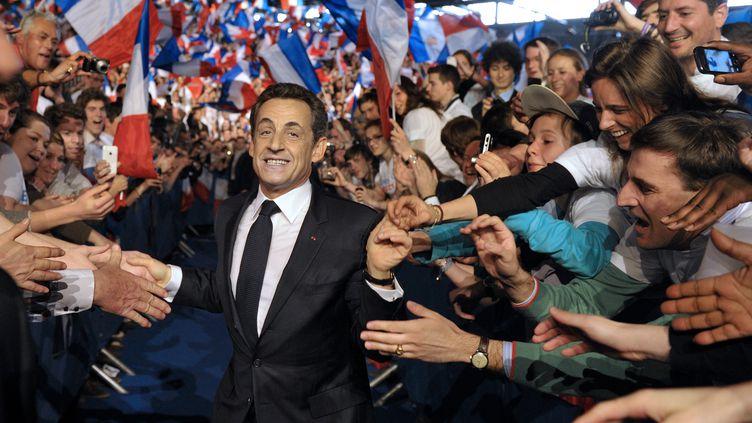 L'ex-président Nicolas Sarkozy le 11 mars 2012 lors du meeting de Villepinte (Seine-Saint-Denis), l'un des rassemblements les plus importants de sa campagne présidentielle. (PHILIPPE WOJAZER / POOL)