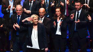Marine Le Pen à l'issue de son intervention en clôture du 16e congrès du Front national, au cours de laquelle elle a annoncé le future nouveau nom que devront valider les militants, le Rassemblement national, à Lille, dimanche 11 mars 2018. (PHILIPPE HUGUEN / AFP)