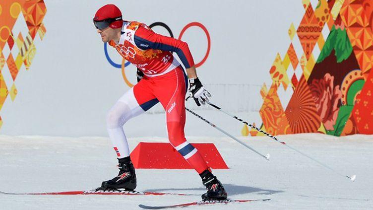 Les Norvégiens dont Magnus Hovdal Moan, champions olympiques du combiné nordique par équipes (ALBERTO PIZZOLI / AFP)