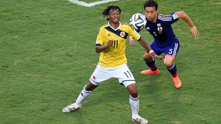 Cuadrado (Colombie) devant Nagatomo (Japon) (JUAN BARRETO / AFP)