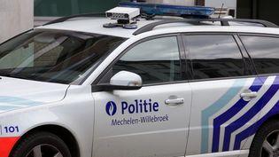 Une voiture de la police belge dans la région de Mechelen-Willebroek, samedi 14 mai 2016. (NICOLAS MAETERLINCK / BELGA MAG / AFP)