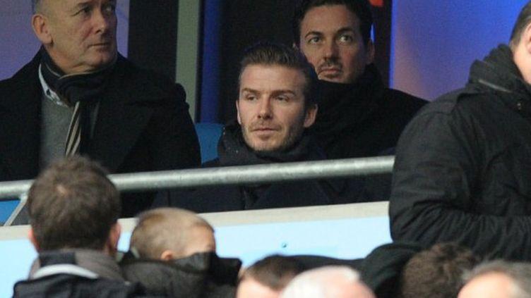 Beckham en tribune (PAUL ELLIS / AFP)