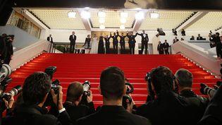 Photographes en bas des marches du palais des festivals, en mai 2014  (Valéry Hache / AFP)