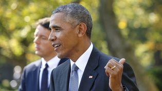 Barack Obama tacle Donald Trump lors d'une conférence de presse avec Matteo Renzi, à Washington le 18 octobre 2016. (KEVIN LAMARQUE / REUTERS)
