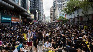 Des manifestants lors de la grève générale à Hong Kong, le 5 août 2019. (ISAAC LAWRENCE / AFP)