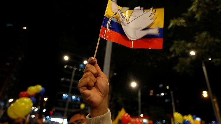 A Bogota, le 24 août, les Colombiens ont célébré la fin de 52 ans d'une guerre civile qui a fait des centaines de milliers de victimes (JOHN VIZCAINO / REUTERS)
